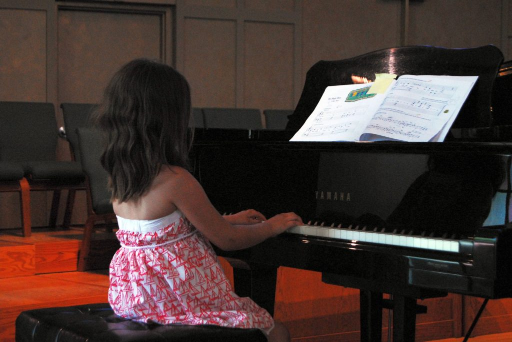 little girl piano