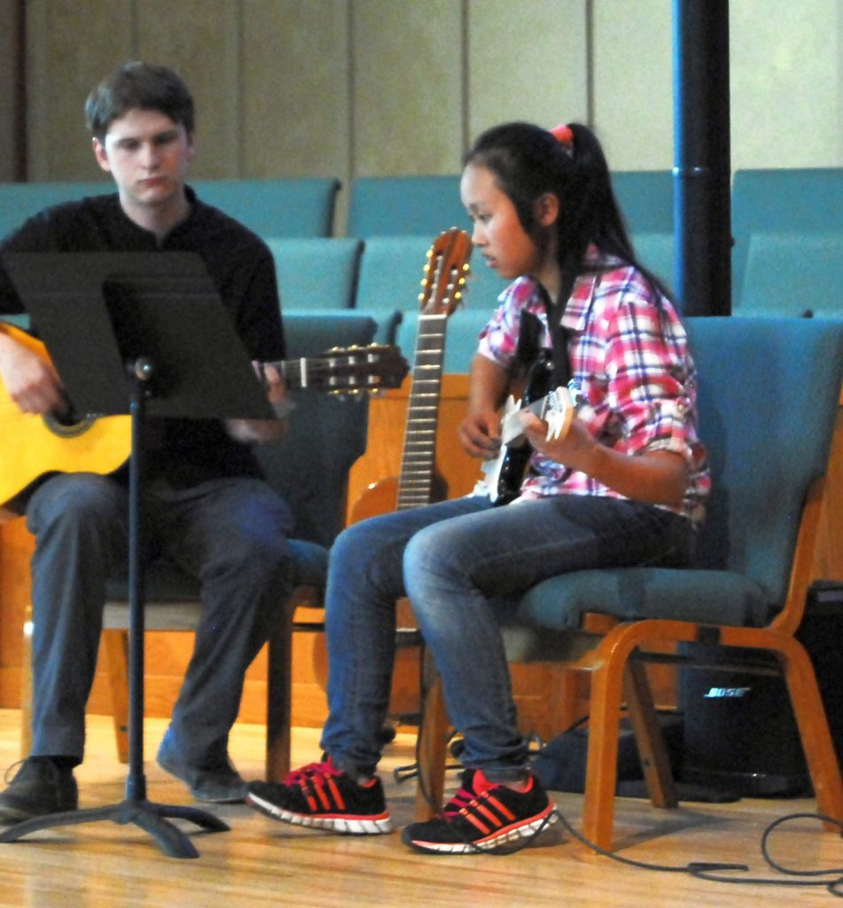 Guitar Teacher and teen student