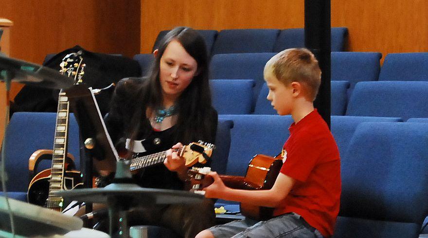 Guitar Teacher and Student