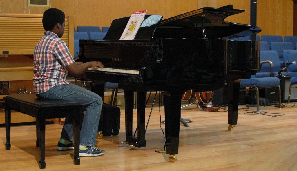 Boy grand Piano