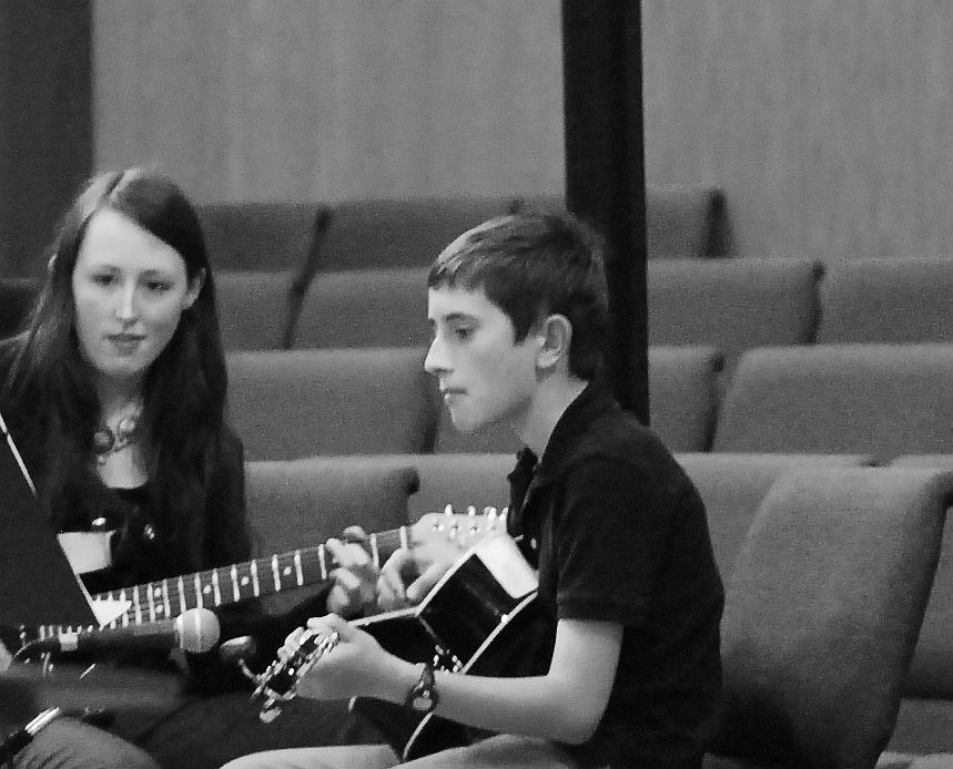 Guitar Student with teacher