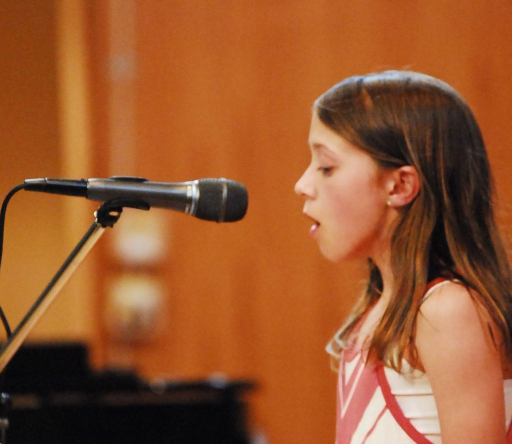 Preteen Girl Singing