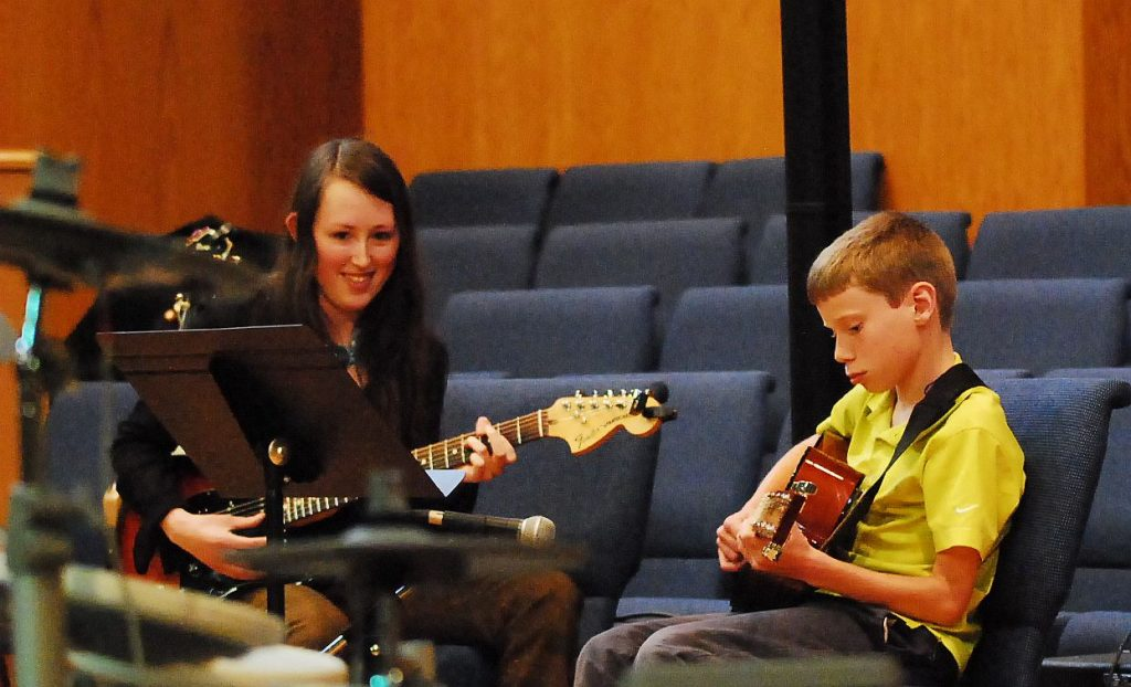 Guitar teacher with student