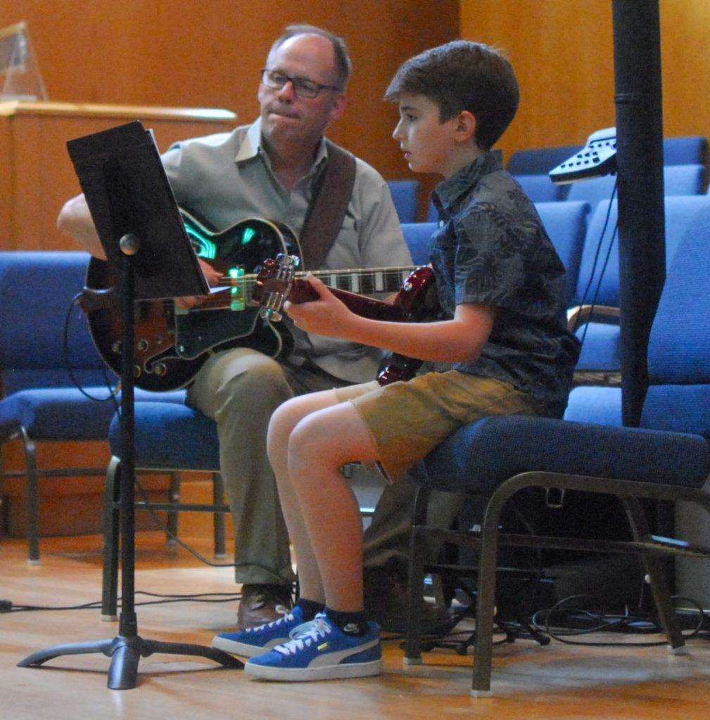 Boy Guitar Student with Guitar Teacher