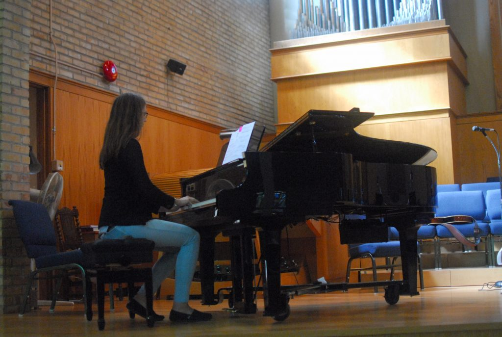 High School  Teen Playing Piano