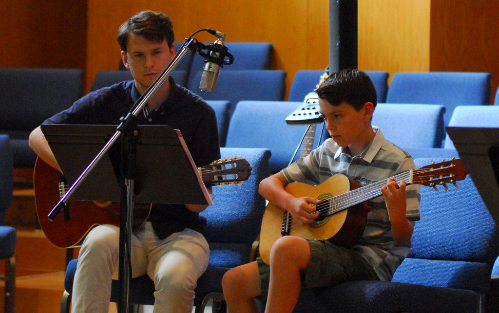 Guitar Teacher with Student