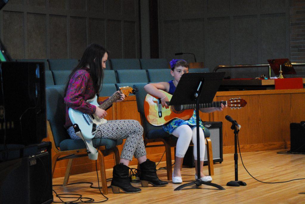 Guitar Teacher and Boy Guitar