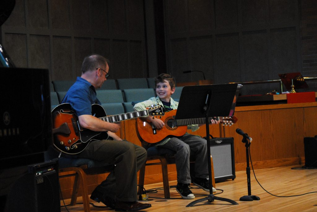 Guitar teacher and Guitar Student