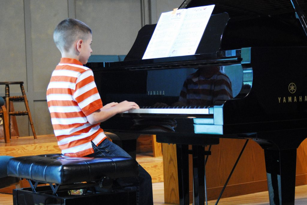 little boy playing piano
