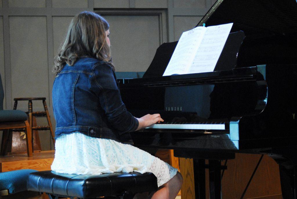 long haired girl piano