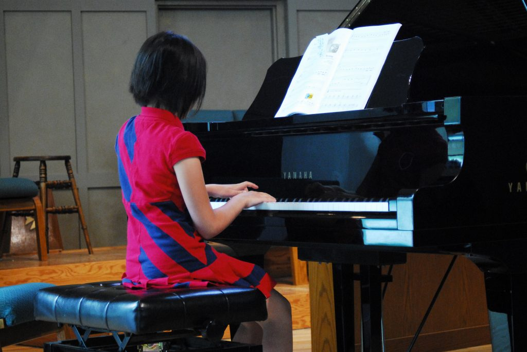 skinny girl playing piano