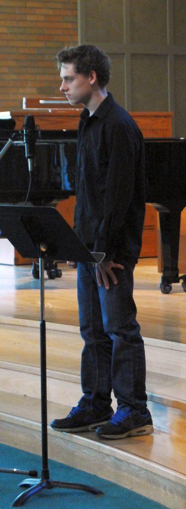 Teen boy singing